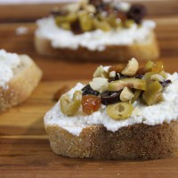 honeyed almond, raisin, olive and ricotta crostini